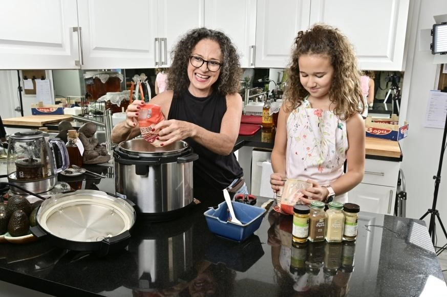 Adita cooking with her daughter