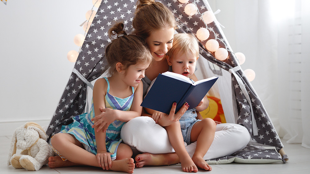 mother reading to her daughters