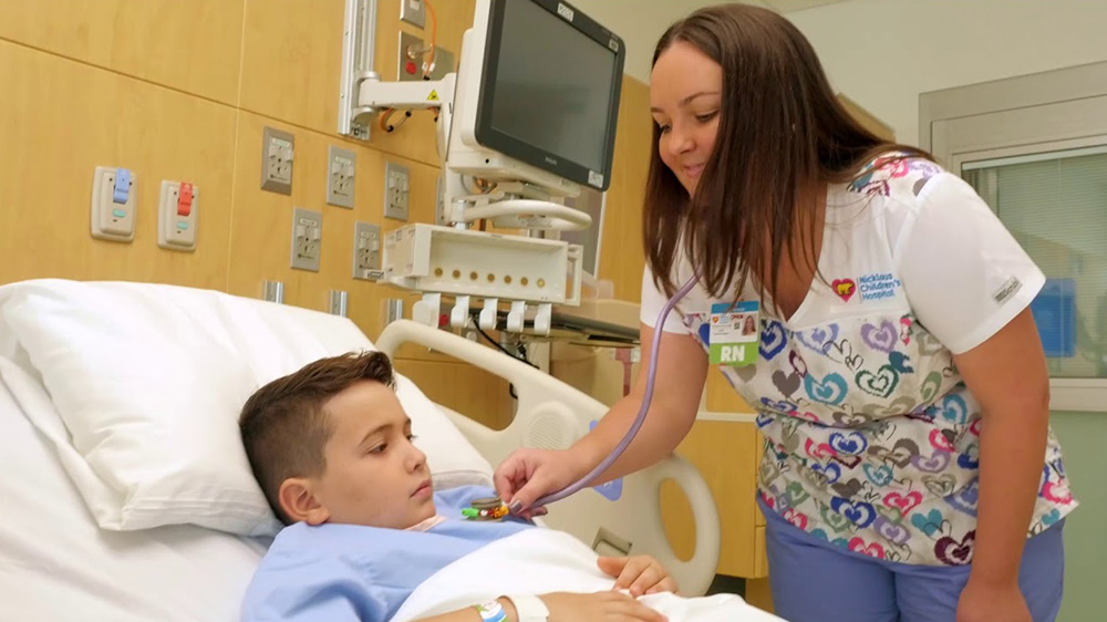 nurse practitioner attending a hospitalized boy