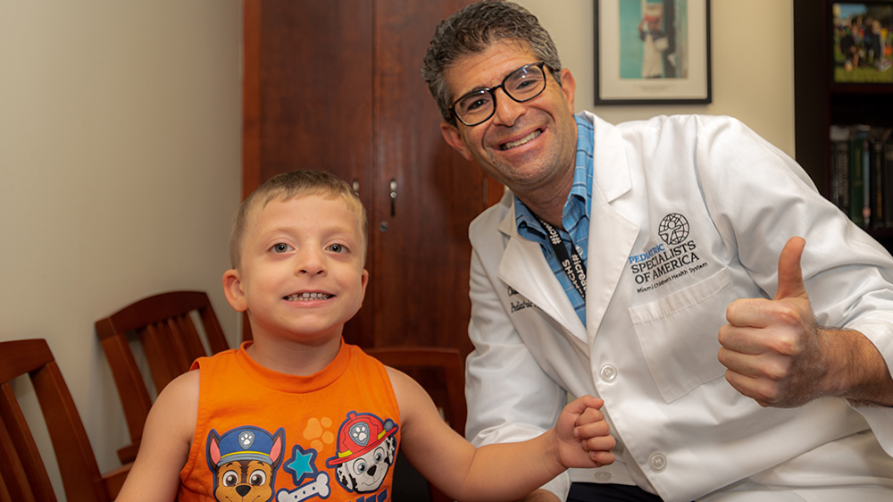 Dr. Perlyn and a young boy treated by the BWS clinic