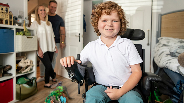 boy in electric wheelchair
