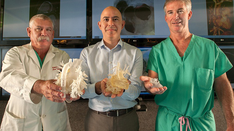 heart program doctors holding 3d printed models