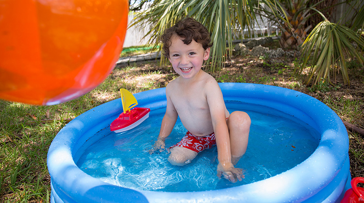 boy playing in a pool