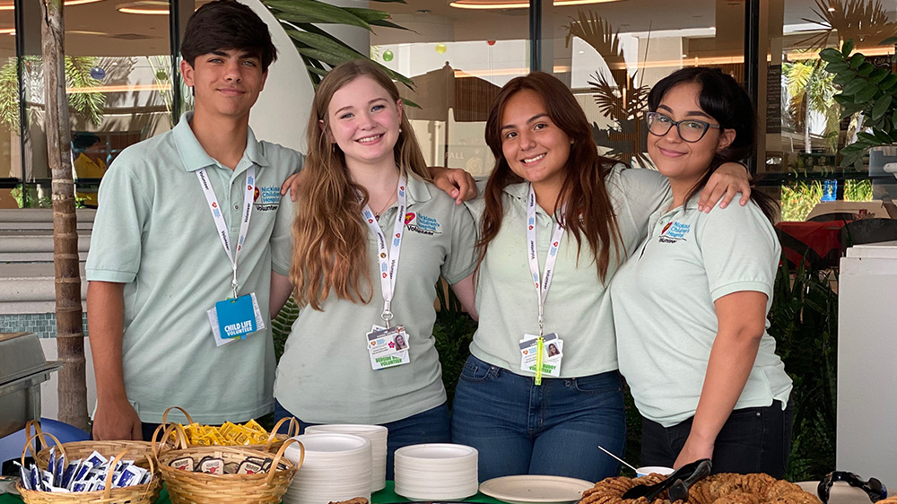 high school volunteers on campus