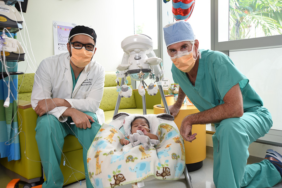 Dr. Ho, baby jarel in his crib, and Dr. Burke