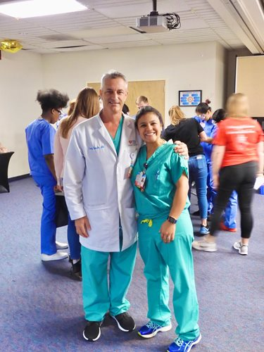 Dr. Spurdle and Dr. Payares in their scrubs