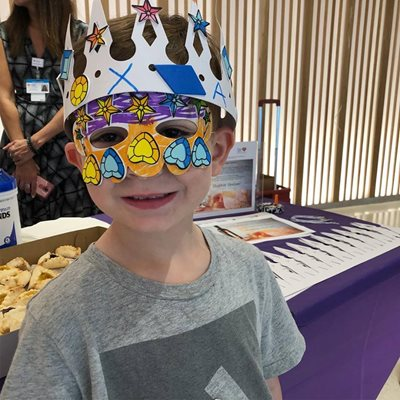 boy wearing purim crown