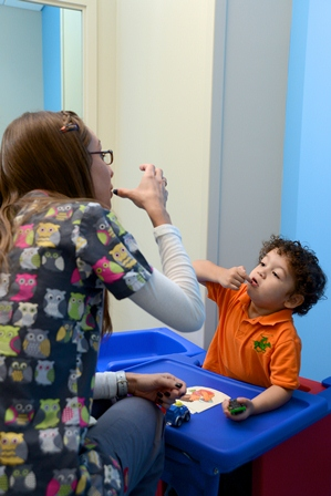 Jennifer Gomez, Speech-language pathologist, and Jacob Iglesias during a speech therapy session at the MCH Miami Lakes Outpatient Center