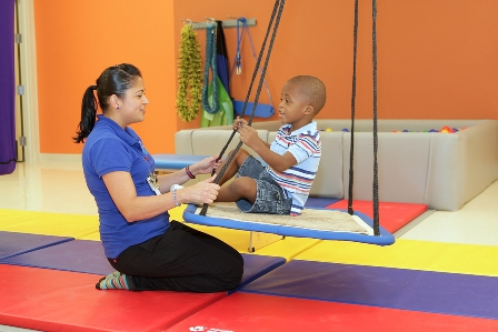 Photo Caption: Carol Monzon, Occupational Therapist, and four-year-old Juanjy Caro during a rehabilitation session at MCH Miramar Outpatient Center