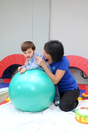 Elizabeth Tubbs, Physical Therapist, and two-year-old Mason Maercks during a rehabilitation session at MCH Midtown Outpatient Center.