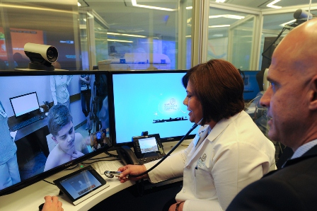 Dr. Deise Granado-Villar, Senior Vice President and Chief Medical Officer and Dr. Erick Hernandez, Pediatric Gastroenterologist, discuss symptoms with a patient in the Ukraine through MCH Anywhere