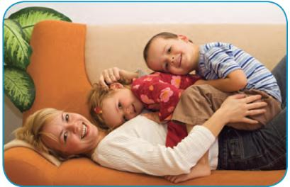 At Miami Children's Hospital we offer a comprehensive array of health services to promote healthy growth and development as well as medical management of acute and chronic conditions .- Image of children laying on mother