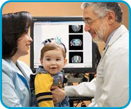 The Miami Children's Brain Institute provides state-of-the-art medical and surgical care for children with a full spectrum of pediatric neurological disorders.-Image Doctor with mother and baby