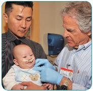 The Craniofacial Center at Miami Children's Hospital Florida's state-designated specialty center for children with craniofacial disorders- Photo of baby boy with doctor
