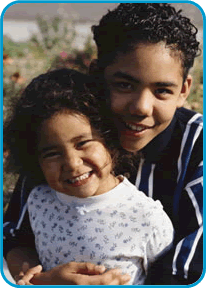 The Division of Clinical Genetics at Miami Children's Hospital provides expert diagnosis, counseling, and treatment of children with a wide range of genetic conditions.-Image of brother and sister smiling