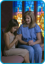Image of nurse with little girl in chapel