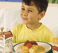 The Division of Pediatric Endocrinology at Miami Children's Hospital offers a complete array of diagnostic, treatment and consulting services for infants, children and adolescents with endocrine disorders. - Image of little boy having breakfast