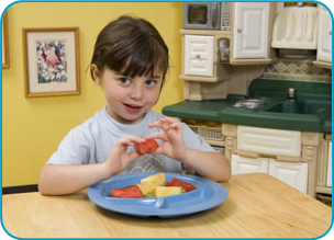 Nicklaus Children's Hospital, formerly Miami Children's Hospital, Food and Nutrition Department provides meals, special formulas, and clinical nutrition services to inpatients.- Image of girl eating fruit