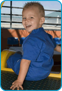 Specilaty Programs and clinics,The Clinical Genetics team conducts initial and follow-up outpatient consultations at Miami Children's Hospital.- Image of little boy smiling
